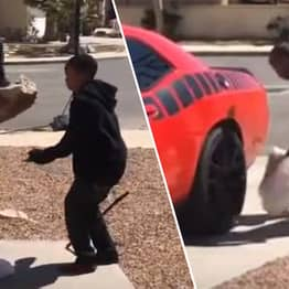 Dad Forces Son To Smash PlayStation With Boulder Then Crushes It With Car