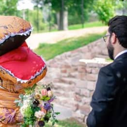 Bride Shocks Groom By Wearing An Inflatable T-Rex Costume To Own Wedding