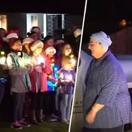 Students Surprise Teacher Battling Cancer With Christmas Carols On Her Front Lawn