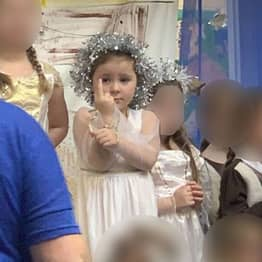 Girl Spends Nativity Giving Crowd The Middle Finger
