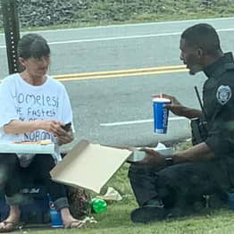 North Carolina Policeman Spends Lunch Break With Homeless Woman After Spotting Her T-Shirt