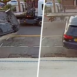Pedestrian Missed By Inches As Out-Of-Control Audi Crashes Into Pavement