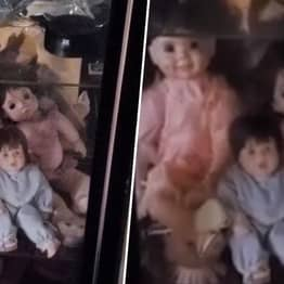 Terrified Man Films 'Haunted' Dolls Moving By Themselves In Glass Cabinet
