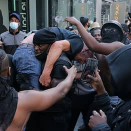 Black Lives Matter Protester Carries Injured Counter-Protester To Safety