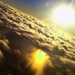 NASA Shares Incredible Photo Of 'Upside-Down City' Beneath Clouds