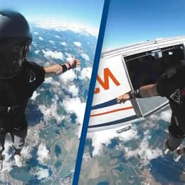 Skydiver's Incredible Leap Of Faith Makes Him Look Like He's Perched On Top Of World