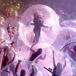 The Flaming Lips Perform Concert With Everyone In Plastic Bubbles