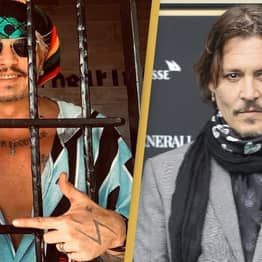 Johnny Depp Bizarrely Poses Behind Bars To Accept Best Actor Award