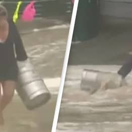 Woman Jumps Into Ocean To Rescue Beer Kegs During Dramatic Flooding In Australia