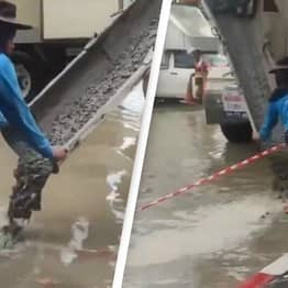 Workers Filmed Pouring Cement Onto Flooded Road After Powerful Storm