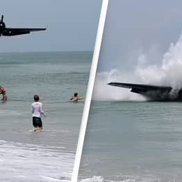 Plane Crashes Into Sea Behind Woman Taking Maternity Photos In Shocking Video
