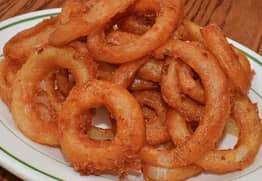 Brit Orders Cheesy Onion Rings Abroad, Gets Surprisingly Weird Meal