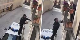 Police Officer Climbs On Car In Spain To Gift Isolated Pensioner Birthday Treat