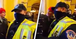 Police Officer Filmed Inside Capitol Building Appears To Pose For Selfies With Rioters