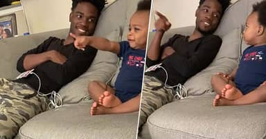 Toddler And His Dad Have Adorable 'Conversation' While Watching TV