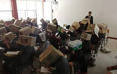 Teacher Forces Students To Wear Cardboard Boxes On Heads To Stop Cheating