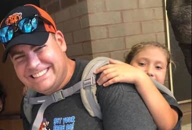 Teacher Carries Wheelchair-Bound Student Through Wildlife Reserve So She Could Attend Field Trip