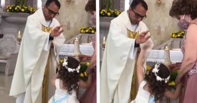 Little Girl High-Fives Priest As He Tries To Bless Her