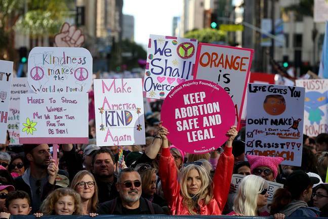 Women and men marching for equality