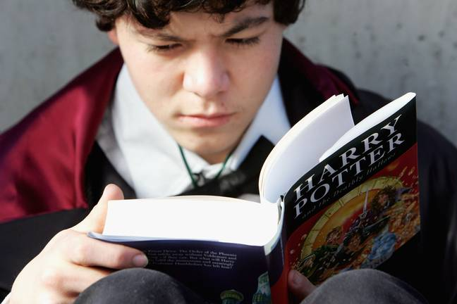 Boy begins to read the final of the Harry Potter books by author J.K. Rowling
