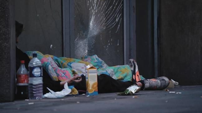 Homeless person asleep on the streets