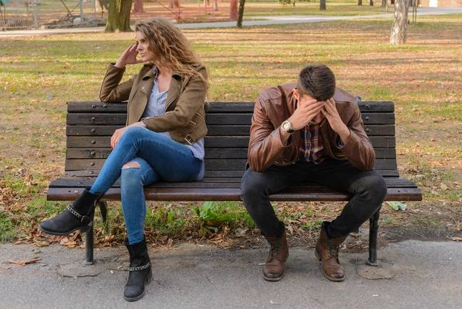 Couple arguing on a bench