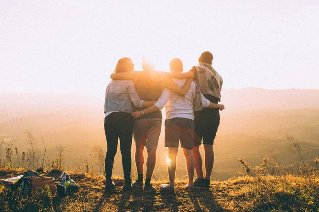 group standing in sunset