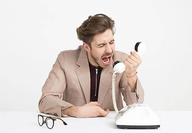 Person angry on phone