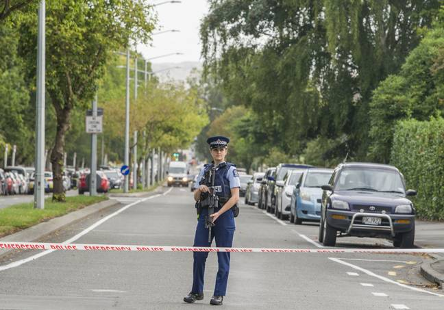 March 15, 2019 - Christchurch, Canterbury, New Zealand - Armed police seal off street to Masjid Al Noor mosque, one of two mosques where gunmen attacked and more than 40 people are dead and injured. Four people have been arrested and several bombs were found following the shootings.