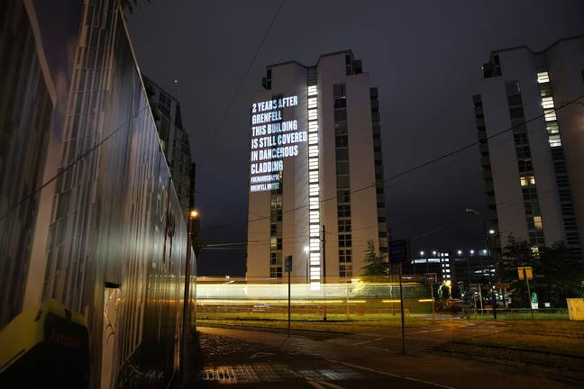 message projected on tower block in manchester