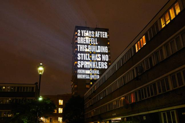 message projected on side of tower block