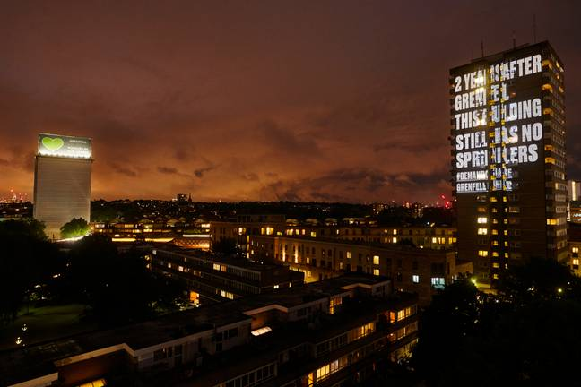 message projected on tower block in london near Grenfell Tower