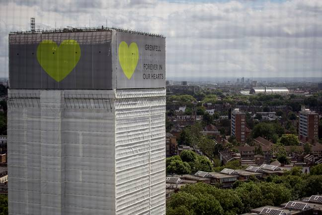grenfell tower wrapped in white plastic