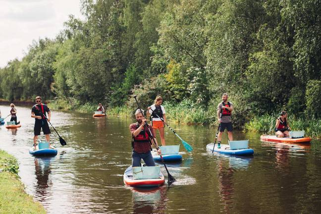 Paddle boarding to collect plastic
