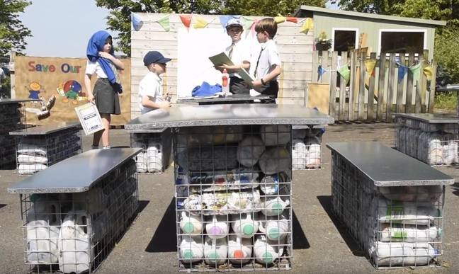 Students use plastic bottles to build classroom