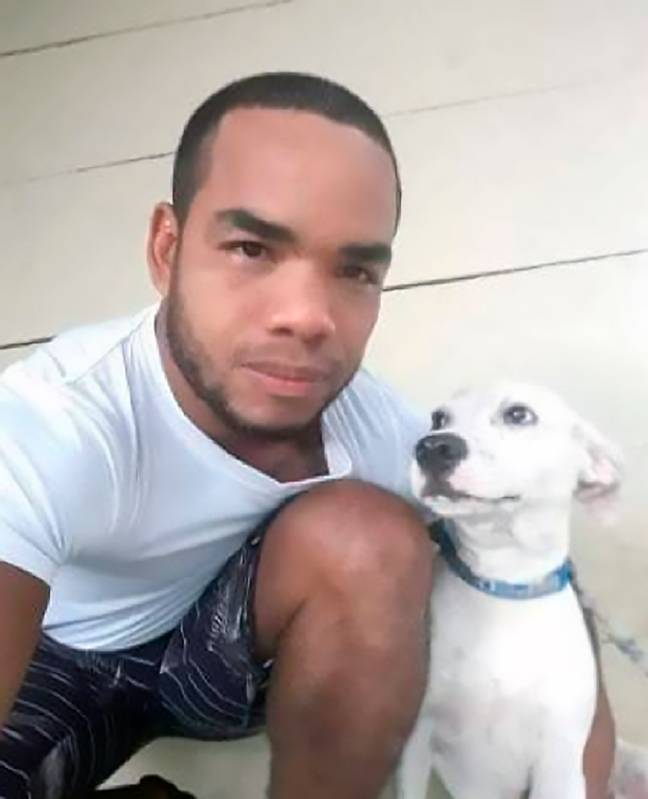 Dog owner posing with dog he rescued from river
