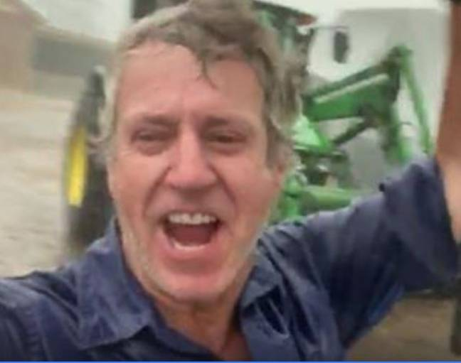 Farmer celebrates as rain falls on his farm after months of drought