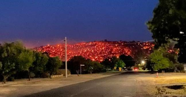 Australia hill glows with fire