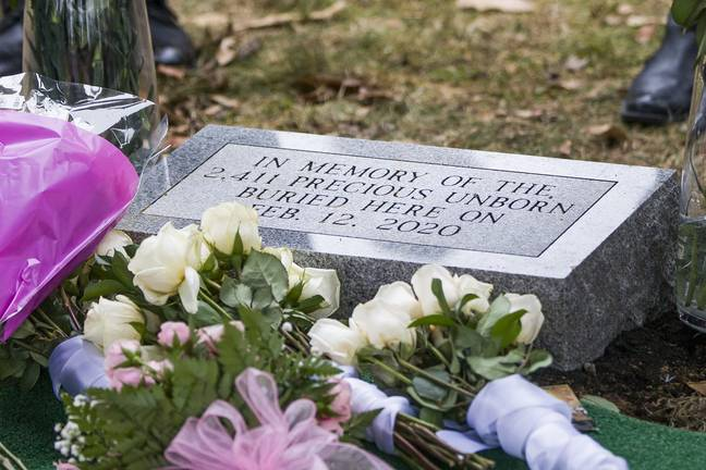 Headstone for mass burial for fetuses found in doctor's garage