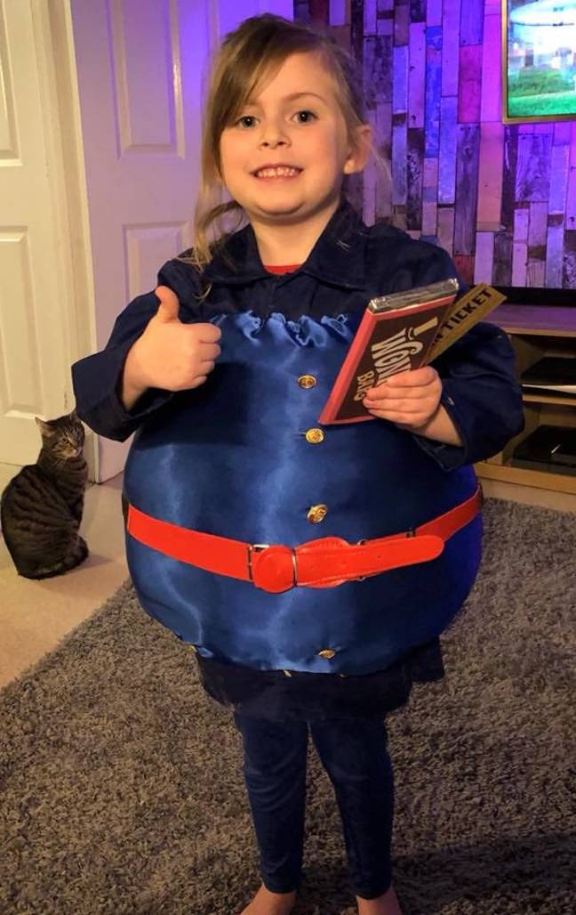 Little girl dresses as Violet from Charlie and the Chocolate factory for World Book Day
