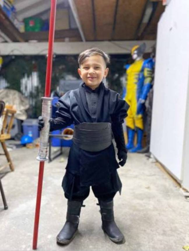 4-year-old in Star Wars cosplay with light saber