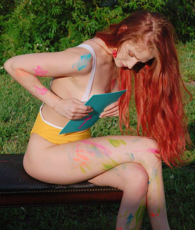 Artist creates paintings using her breasts