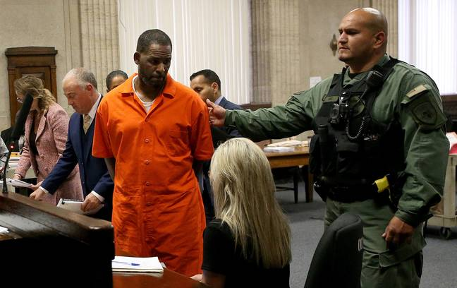 R. Kelly being held in court (PA Images)