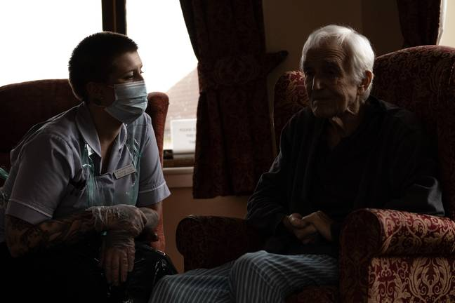Jack Dodsley, 79, with a carer in PPE at Newfield Nursing Home, Sheffield,