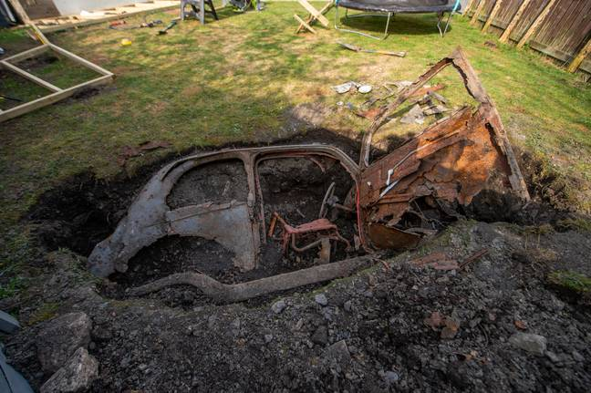 Man finds classic car buried under his garden