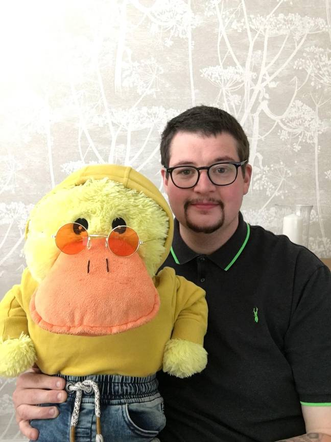 John Junior and toy duck Charlie