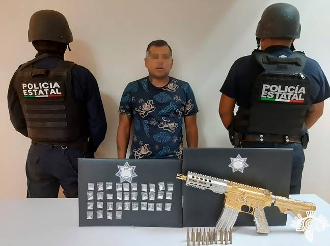 Police seize drugs and golden gun from gang in Mexico