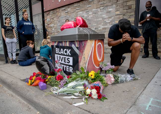 Protesters mourn death of George Floyd after officer knelt on his neck