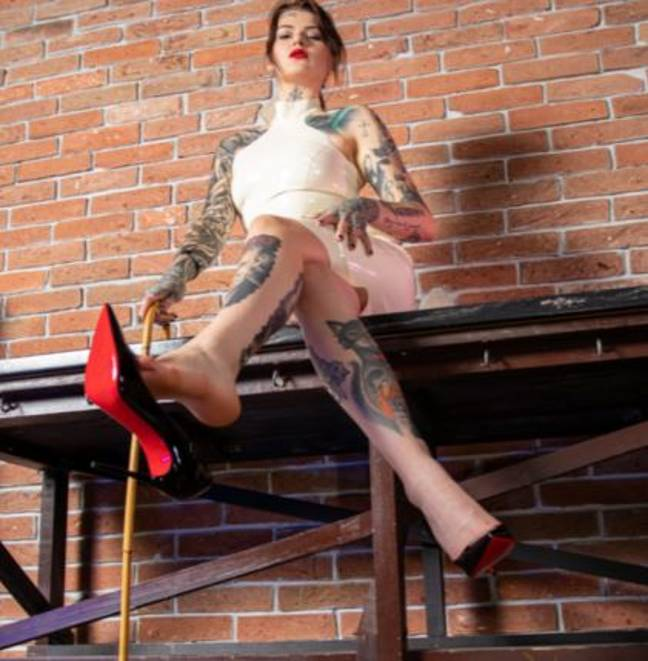 dominatrix gets paid to run over laptop 1