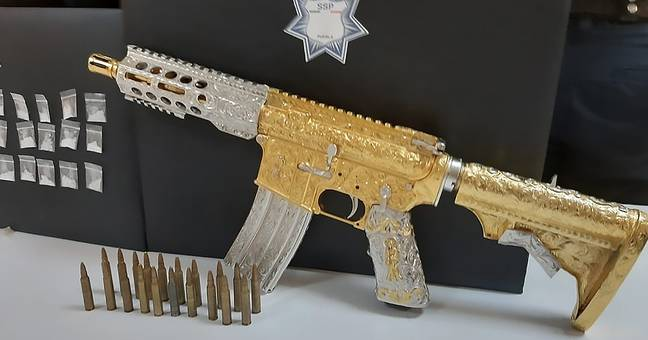 Mexican Police Seize Gold Machine Gun From Cartel Boss Of Women With Moustaches Gang